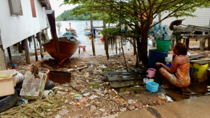 Gypsie town in south Koh Lanta. That's how they take a bath, next to the road..