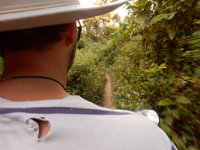 Driving through the narrow paths on Don Khon with the scooter